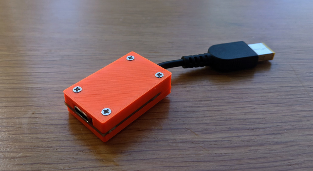 Thinkpad adapter with 3D printed orange case